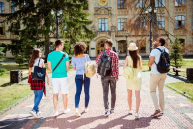 """A group of college students walk in a link towards campus. Life transitions counseling in Michigan can offer support with new beginnings. Learn more about transitions counseling in Michigan or search """"life transitions counseling in West Bloomfield, MI"""" today.:"""