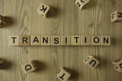 """An image of letter blocks spelling out the word """"transition"""" for Therapyology. Contact us for life transitions counseling in Michigan. Transitions counseling in West Bloomfield, MI can help you to live your best life!"""
